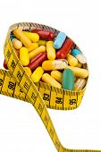 tablets and measuring tape, symbol photo for appetite suppressant, diet pills and thinness