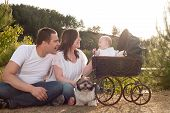 Happy Family With Vintage Pram