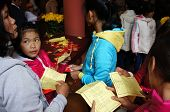 Vietnamese Pick Lucky Present On Tet, Traditional Culture