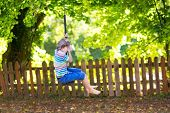image of playground school  - Cute School Boy Enjoying A Swing Ride On A Playground On A Warm Sunny Summer Day