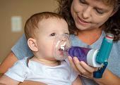 picture of exhale  - Infant getting breathing treatment from mother while suffering from illness - JPG
