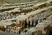 foto of qin dynasty  - Terracotta warriors in formation displayed in a burial pit at the Terracotta Army Museum in Xian China - JPG