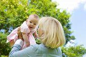 Grandmother Lifting Grandchild Up
