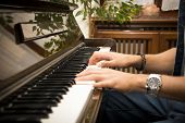 Male Hands Playing Piano Indoors