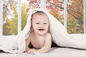 Excited Baby Laughing On Bedroom
