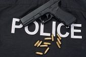 9Mm Handgun With Ammo On Police Uniform