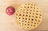 Baked Apple Pie Against Wooden Background