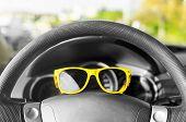 Yellow Glasses On The Wheel.