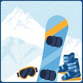Snowboarding equipment on background of mountain landscape.