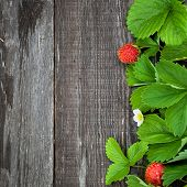 Background With Ripe Strawberry On Wooden Surface.