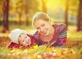Happy Family: Mother And Child Little Daughter Playing And Laughing In  Autumn