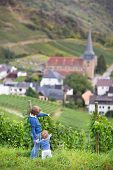 Young Brother And His Baby Sister Watching A Beautiful View Of A Germany Small Village