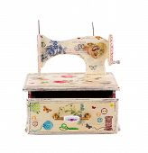 Jewelry case with sewing machine.