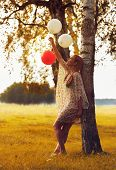 Woman Playing With Balloons