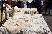 Table cloths with embroidery on a market