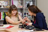 Makeup Artist Shows The Customer Lipstick