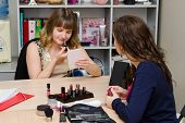 Beauty Consultant Monitors The Client Coloring Lips