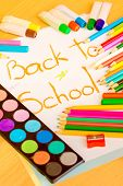 Back to school - Colorful art supplies framing the words BACK TO SCHOOL