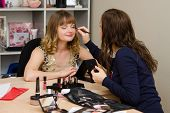 Beauty Consultant Brings Eyelashes Client