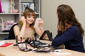 Girl Paints Eyelashes On Leadership Consultant