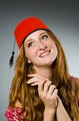 Woman wearing red fez hat