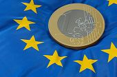 Euro coin on flag