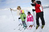 pic of family ski vacation  - Family of four skiing together in winter - JPG