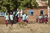 TORIT, SOUTH SUDAN-FEBRUARY 20, 2013: Unidentified schoolchildren are released from school in the village of Torit, South Sudan