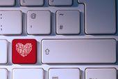 Maze heart against red key on keyboard