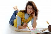 Artist Intently Draws Lines On The Paper Ld