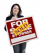 Hispanic Woman Holding Sold For Sale By Owner Real Estate Sign Isolated On White.