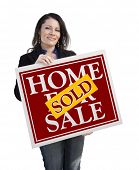 Hispanic Woman Holding Sold Home For Sale Real Estate Sign Isolated On White.