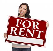 Happy Mixed Race Female Holding For Rent Sign isolated on White.