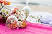 Dining table setting with flowers, and glasses, closeup, outdoor wedding table setup