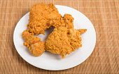 Fried Chicken On White Plate And Bamboo Mat