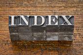index word in mixed vintage metal type printing blocks over grunge wood