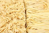 Different dry instant noodles close-up background