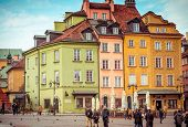 WARSAW, POLAND - November 1, 2014: tourists and locals enjoy the historical center  on November, 1, 2014 in Warsaw, Poland