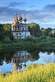 VOLOGDA, RUSSIA - JUNE 12, 2011: Church of St. John Chrysostom on the bank of river Vologda. Built in 1644, the church is one of the oldest stone buildings in the city