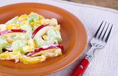 Waldorf salad with salad pepper on plate on table close up