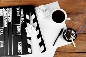 Movie clapper with cup of coffee and ashtray with cigarette butts