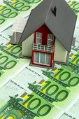 house on banknotes, symbolic photograph for home purchase, financing, building society