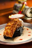 Crisp Salmon Steak with Black Risotto and Cream Sauce