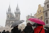 PRAGUE, CZECH REPUBLIC - FEBRUARY 23, 2013: Heavy snowfall covering the Tyn Church on Old Town Square in Prague, Czech Republic.