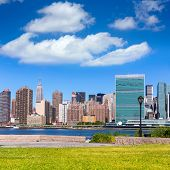 Manhattan New York sunny skyline from green park turf East River NYC USA