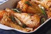 Chicken Legs With Rosemary In A Baking Dish Macro Horizontal
