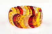 Amber bracelet on white background