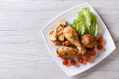 Chicken Legs With Mushrooms And Tomatoes Horizontal Top View