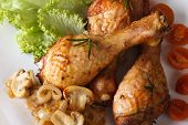 Fried Chicken Legs With Mushrooms Close-up. Horizontal Top View