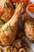Fried Chicken Legs With Mushrooms And Vegetables Macro Top View